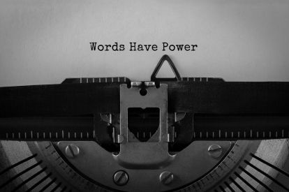 "A typewriter with a page that reads ""Words Have Power"";"