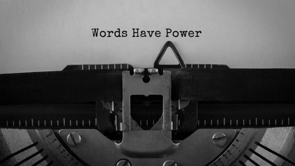 """A typewriter with a page that reads """"Words Have Power"""";"""